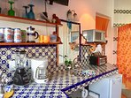 You will have everything you need in this pretty and compact kitchenette
