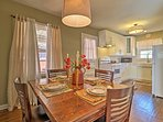 Sit at the 4-person dining table for a delicious family meal.