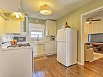 Hardwood floors lead you into the fully equipped kitchen.