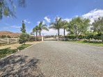 A large driveway with gated entry leads you to your Temecula wine country paradise.