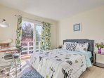 The third bedroom is draped in elegant floral decor.