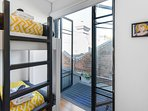 Doors open to small balcony in 4th bedroom