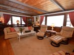 Spacious 25x15 Living room with plenty of seating and large windows