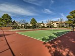 Play tennis with your loved ones on the community courts!