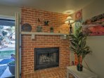 The red-brick fireplace adds charm to the unit.