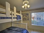 The bunk room features a twin-over-full bunk bed and a full trundle bed.