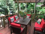 The extra large deck overlooking the waterfalls and swimming hole. Dine in the tree-tops!