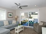Lower unit: 1st level - Comfortable living area opening to furnished patio area