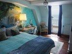 Bedroom 1. with queen size bed and en-suite bathroom. Balcony overlooking la Concha beach.