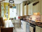 Our kitchen with dish washer, washing machine, oven and gas burner stove top.