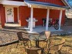 Private backyard with grill, lockable bike rack, bike/dog wash area, seating.