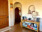 Authentic hand carved doors, arched doorways, lit nichos - beautifully constructed home.