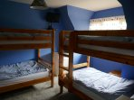 Upstairs bunk bed room most suitable for children with 2 sets of bunks, wardrobe, TV
