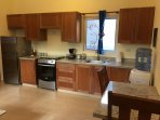 These are the kitchens in the one bedroom condos. They have everything you need to prepare a meal.