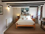 Large downstairs double with split level floor and exposed beams