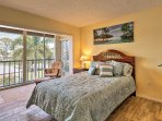 The second bedroom features a comfortable queen mattress.