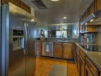 The kitchen comes complete with stainless steel appliances.