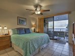 The master bedroom is highlighted by a king bed and sliding doors to access the lanai.