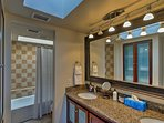 This Jack-and-Jill style bathroom is shared between the 2 bedrooms.