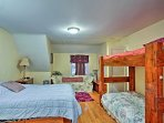 There's 1 queen bed, 1 daybed with twin trundle, and 1 twin-over-twin bunk bed.