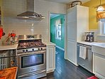 Stainless steel appliances are complemented by the modern quartz countertops.