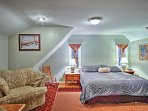 A spacious king bedroom is waiting to provide you with comfortable and spacious sleeping quarters.