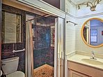 There's a marble shower and radiant floor heat in this en-suite bathroom.
