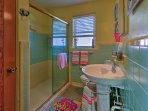 Rinse off the sand and salt in the large walk-in shower with glass doors.