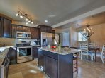 This fully equipped kitchen is adorned with new renovations and appliances.
