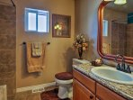 This full bathroom boasts new tile and a shower/tub combo.