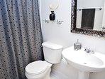 Full bathroom with bath tub and shower