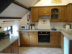 Well-equipped kitchen with fan oven, induction hob, microwave, dishwasher, fridge, toaster & kettle