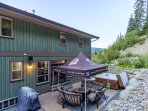 Very private back yard with beautiful outdoor furniture, fire pit, BBQ, hot tub