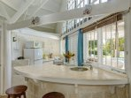 The well equipped kitchen with views of the pool