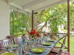 Mullins Bay House deck with outdoor dining table overlooking the pool &