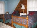 Twin beds in upstairs bedroom