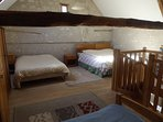 The family bedroom has two double beds and two single beds.