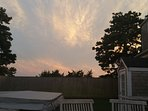 A beautiful summer sunset with snacks and drinks in the backyard.