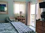 Master bedroom with sliding door to deck and ocean view!  See & hear the ocean from the bed!