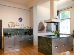 Cooking island and sinks, all green marble from Italian alpes.