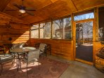 screened porch overlooks back deck, BBQ & gardens