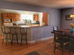 Large kitchen with bar just off the dining room