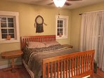 Master bedroom with queen and double sliding doors to screen porch...