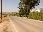 the road of your house with a big  garden, parking and vineyard