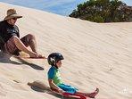 Tobogganing little Sahara and sand boarding