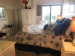 Master suite w/view towards veranda and ocean; new sliding blinds and wood flooring