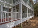 There are two screened in porches and one open deck area for outdoor gatherings or relaxing