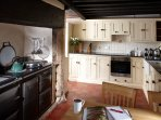 Large farmhouse kitchen complete with AGA and feature bread oven.