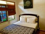 Queen Bedroom, with wardrobe, tallboy cupboard,bedside table,Tamp ceiling fan,pool view,air-conditio