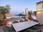 seating and dining areas on private roof top terrace